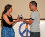GVS Founder Sally Carless accepts the 2009 Noble Peace Prize from OPC Director evan austin